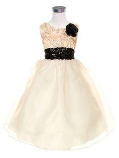 A beautiful Organza skirt girl dress with Satin bodice filled with rolled rosettes and accented by black sequined waist and black pin on flower