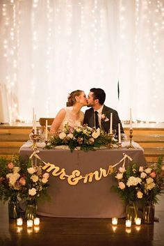 Stunning and elegant January winter barn wedding close to Salem, Oregon. Mr & Mrs sweetheart table with twinkle light backdrop and bride and groom kiss barn wedding inspiration Diy Wedding, Rustic Wedding, Wedding Ceremony, Wedding Flowers, Dream Wedding, Wedding Day, Trendy Wedding, Wedding Receptions, Wedding Signs