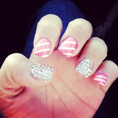 pink and white stripes. silver sparkle studs. accent nail