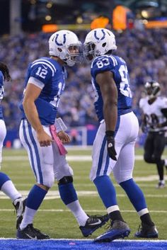 Indianapolis Colts Quarterback Andrew Luck (12) celebrates with Indianapolis Colts Tight End Dwayne Allen (83) during a game against Raven, 05.10.2014