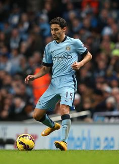 Jesus Navas of Manchester City controls the ball during the Barclays Premier League match between Manchester City and Swansea City at Etihad Stadium on November 22, 2014 in Manchester, England.