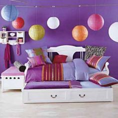 modern Girl Bedroom Interior  With Colorful Ball Lantern And Purple Wall Paint Color  a part of Pale Pink Colored Girl Bed With White Book Shelvesand Hardwood Floor under Bedroom