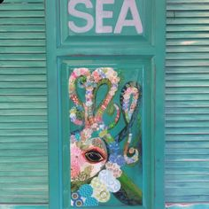 Most alluring magical creature of the sea. This is a stunner! Brimming with pattern and color on a reclaimed cupboard door. Emerald/Jade green background finished in glassy overlay.
