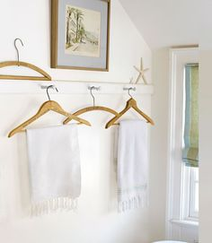 nice idea for towel hanging in laundry rm