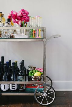 Perfect pops of color on this lovely bar cart.