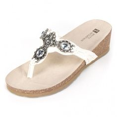 White Mountain Shoes Cardenia Off White Sandal Molded footbed with stone and pewter embellishments. Lace detail. Feast your eyes on these glamorous slip on sandals. Perfect for all occasions.