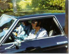 Elvis and John O' Grady leave Elvis' Hillcrest home in his Stutz Blackhawk
