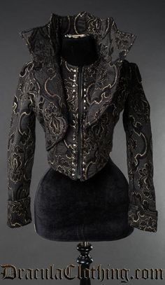 A beautiful thick black and gold brocade material jacket made for all evil and vampire queens out there. The pattern is woven in two layers. The collar is sturdy and stands up on its own.