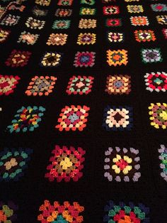 traditional granny square worked in a multi color design assorted colors to match any decor queen sz and is base color is black and trimmed in black as well easy care/ machine wash and dry moth proof/shrink proof/fade resistant/ hypo allergenic yarn