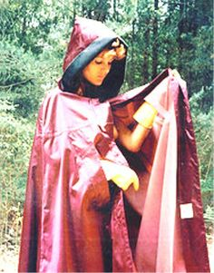 Lovely rubberlined red satin cape - not forgetting the rubber gloves !