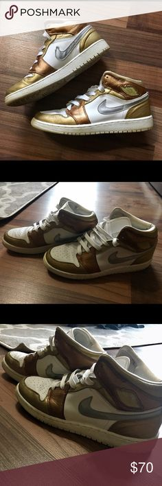 ⭐️NEW LISTING⭐️ Nike Air Jordan High Tops Beautiful Nike Air Jordan's! Love but still in good condition. Combination of white, gold, bronze coloring. Super comfortable! Size 7 Youth fit like an 8 for woman. 15% off bundle with purchase of two or more items. ♥️ Nike Shoes Sneakers