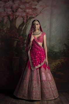 Bridal Lehengas - Pink Bridal Lehenga by Sabyasachi | WedMeGood | Pink Bridal Lehenga with Dull Gold Broad Border and Pink Choli, Pink Dupatta with Scattered Gold Small Booties  #wedmegood #sabyasachi #indianbride #indianwedding #pink #lehenga #bridal #choli