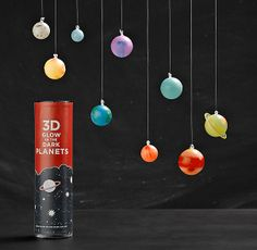 """glow-in-the-dark 3–D Planets for kid's room: """"colorful plastic orbs...shaded and scaled to represent our solar system's planets (including the dwarf planet Pluto), they come with string and adhesive putty, so you can suspend them from the ceiling without tacks or tape."""""""