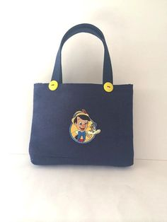 Navy Blue and Yellow Pinocchio Tote Bag on Etsy, $24.00