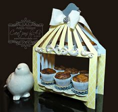 "$5 Downloadable DESSERT CAGE Template What a fun way to display dessert in this bird cage shaped stand! The stand includes two shelves with a self-closing top. A nice display for teas, weddings and birthdays!  (Holds up to nine mini-cupcakes!)  FINISHED SIZE  Width: 6-3/4""  Height: 9""  Depth: 2-3/4"""