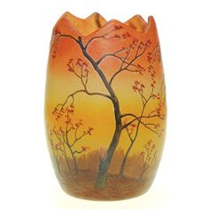 LEGRAS CAMEO VASE DISPLAYING TREES IN A FIELD, THE BRANCHES SPARSE WITH FALL FOLIAGE AND SILHOUETTED AGAINST A COLORFUL EVENTIDE SKY, THE SURFACE TREATED WITH ENAMELING