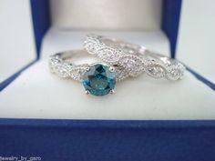14K White Gold Blue & White Diamond Engagement  Ring  Wedding Band Sets 0.77 Carat Handmade. $1,700.00, via Etsy.