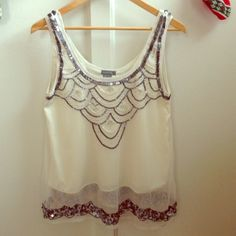 Sequin Embellished Mesh Overlay Tank Sequin Embellished Mesh Overlay Tank. Worn once. Some beads missing but hardly noticeable (2nd photo). Great for parties! Size XS but lays loose. 100% Nylon. Angie Tops