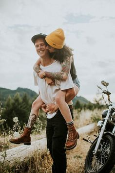 With band tees, worn denim, tattoos, and a motorcycle, these aren't your average engagement photos | Image by Dawn Photography