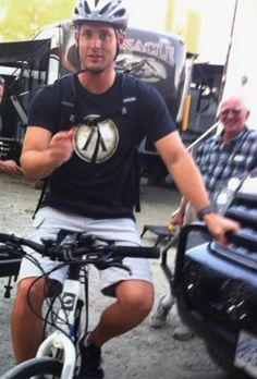 Jensen Ackles on the bike candid. Thank you for wearing a helmet, Jensen. :)