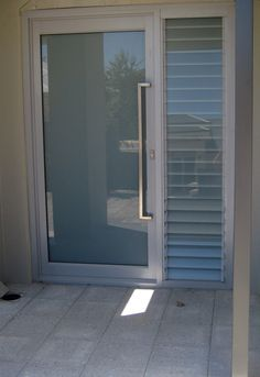 Frameless exit door - using Dorma panic bars part of our ...