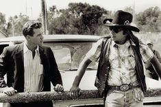 Graham Greene (right) costarred with Val Kilmer (left) in the 1992 Michael Apted-directed Thunderheart. He relished his role of Walter Crow Horse, a character created by the film's screenwriter John Fusco. Val Kilmer, Movies Showing, Movies And Tv Shows, Native American Movies, American Indians, Fred Ward, Graham Greene, Dances With Wolves, Tv Westerns