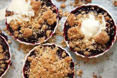 Warm huckleberries—though blueberries will work in a pinch—bubble away under a crumble of brown sugar, walnuts, and oats in this homey dessert.