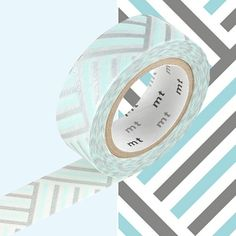 A beautifully designed white, baby blue and silver MT washi tape with a herringbone, cross hatch style pattern.