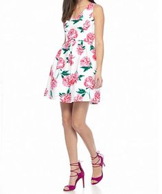 A bold pink peony floral print and sleek fit-and-flare silhouette combine to take this must-have dress to another level. Crafted with a face-framing neckline and chic, classic details, it's perfect for stepping out in style at the next party.