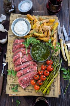 Tomahawk steak by Château Boeuf® with chimichurri, potato wedges and asparagu.