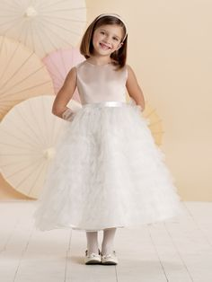110306 Sleeveless satin, tulle and organza tea-length A-line dress with satin ribbon tie at natural waist, multi-tiered and ruffled tulle full skirt. Also available in baby sizes 6 mos. – 24 mos. as style110306Bin Ivory/Blush, Ivory and White. Sizes:2 – 16 Colors: Champagne/Ivory, Ivory/Blush,White, Ivory