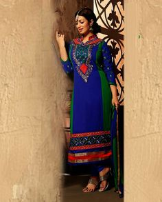 Blue and green embroidered suit   1. Blue and green georgette suit2. Thread embroidered patch yoke with motif sleeves3. Golden and red border with embroidery on hemline4. Comes with matching bottom and dupatta5. Can be stitched upto size 42 inches