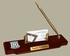 Professionally display your business cards with our desk set showcasing a medallion of your school seal with a solid brass business card holder and ball point pen. Available in gold or silver finish. Search for your school or institution!