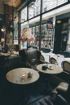 nice leather chairs and I love the deer skull and antique lampshades... good style.                                                                                                                                                                                 More