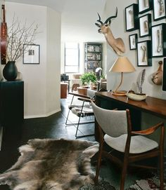 Masculine = browns, khaki, grey, black. Metal sculptures, wood, (never, never, never will it include taxidermied animal parts.)    Okay lady, this is how we decorate for our husbands.