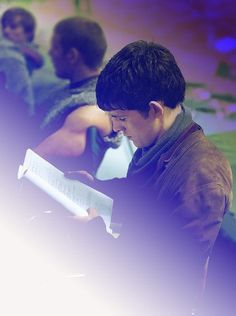 Colin studying his script.