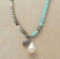 Naomi Herndon sees beauty in imperfection, embodied by a baroque cultured pearl. Complementary elements include turquoise, labradorite and sterling silver paillettes. Handcrafted exclusive