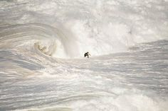 A surfer ending a giant wave in Nazaré North Canyon, Portugal. Photo by Rui Caria. (an entry in the National Geographic Traveler Photo Contest) Giant Waves, Big Waves, Indoor Outdoor, Outdoor Camping, Kitesurfing, Portugal, Snowboarding Mountains, National Geographic Photo Contest, Outdoor School