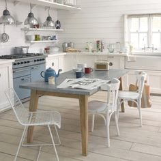 Love zinc covered tables & counter tops. Zinc kitchen table from Loaf.