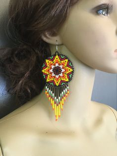 A personal favorite from my Etsy shop https://www.etsy.com/listing/477278274/huichol-long-beaded-medallions-earrings