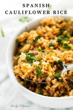 This easy to make Spanish Cauliflower Rice is low carb, keto, gluten free and paleo. It can be made with fresh or frozen riced cauliflower #lowcarb #keto #paleo #cauliflower #cauliflowerrice #wendypolisi