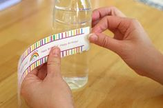 DIY Water bottle labels using clear packing tape for protection