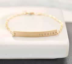 Gold Nameplate Bracelet Gold Bar Bracelet by TheSilverWren on Etsy, $38.00 (with baby's name)