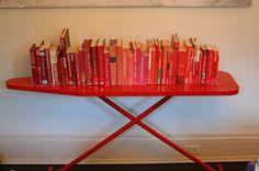 Looking for cheap DIY bookshelf or book display ideas? Find out how to build functional, inexpensive, DIY bookshelves for your home. Old Ironing Boards, Iron Board, Red Books, Reuse Recycle, Mobile Bar, Organization Hacks, A Table, Shelving, Repurposed