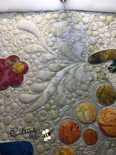 Spring Bouquet by Edyta Sitar. Quilt made by Lee Nicholsen and quilting by Kelly Corfe. Innova Longarm Distributor