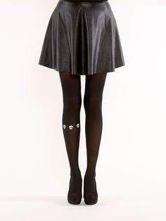 Super unique Skulls around one leg tights! Semi-opaque black tights with small white skulls on the right leg. The material is super soft, fits nicely thanks to its comfortable stretch.