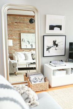 Interior Crush: The Everygirl Co-Founder Danielle Moss's Chicago Apartment Tour, featuring IKEA wall mirror | see more on alittleleopard.com and the full tour on theeverygirl.com