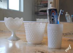 Milk glass bathroom accessories