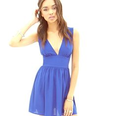 Forever 21 blue dress Cute royal blue dress, v-neckline! Perfect condition, only worn once! Looks super cute under sweaters for the daytime when you're not in the mood for a plunging neckline. Forever 21 Dresses Mini