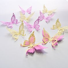 Orchid and light yellow paper butterflies wall stickers. Set of 18. Hang them on the wall in a bedroom or on the wall for a party and the walls come to life with the fluttering of butterfly wings. Details: • card stock paper • set includes: 18 butterflies 2.7 x 3.5 • includes adhesive